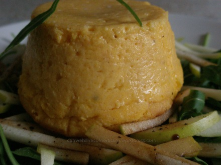 Carrot souffle on apple and rocket salad with balsamic vinegar